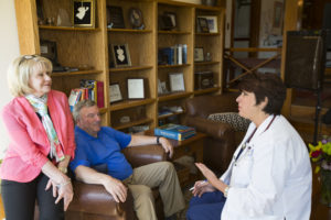 Hospice doctor communicating with family